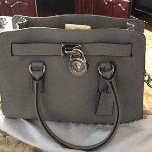 Gray Michael Kors handbag